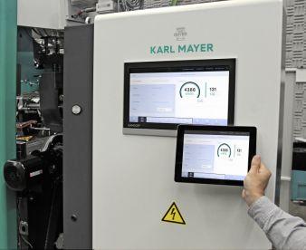 Der Karl Mayer-Stand wird auf der diesjährigen ITMA schon nach kurzer Messelaufzeit zum Meetingpoint der Wirkerei- und Kettvorbereitungsindustrie...