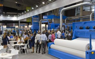 Blick auf den Dilo Stand – ITMA Barcelona 2011 Photo: Dilo Group